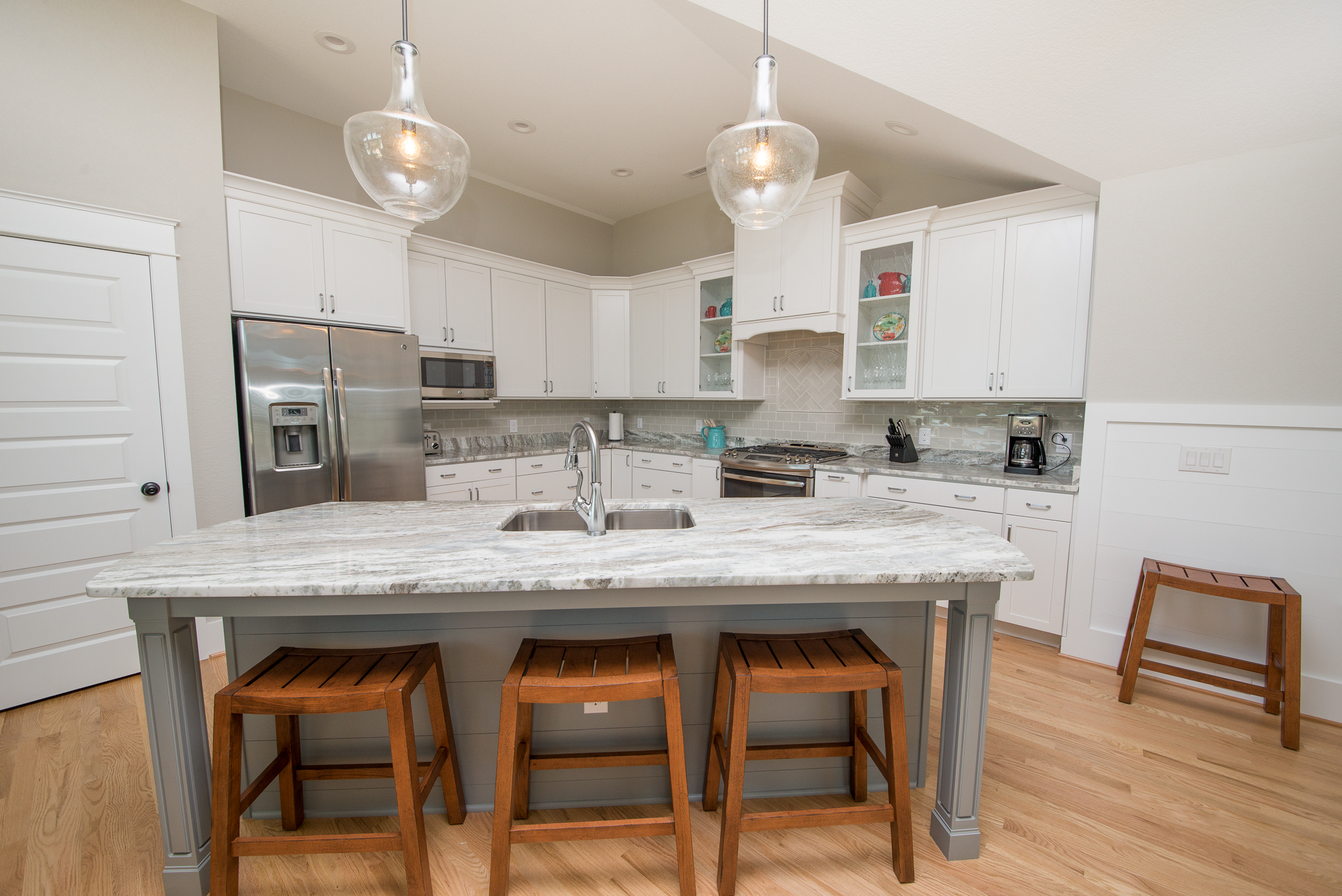 Stainless steel appliances, center island and granite countertops