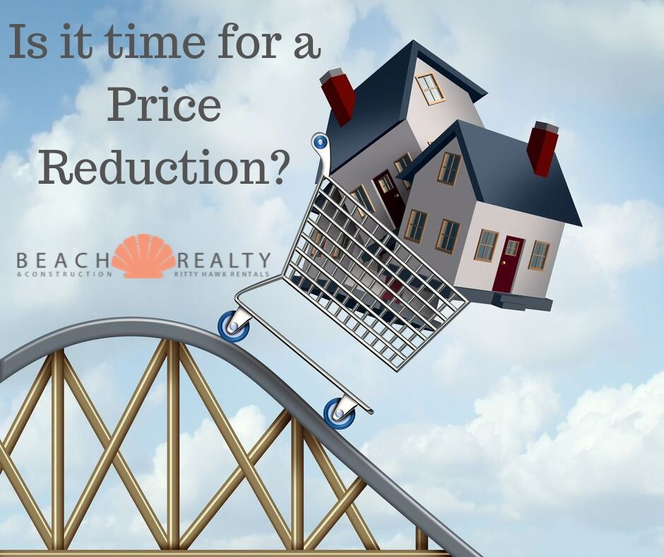 Is it time to reduce the asking price of your home? Homes in a cart on a roller coaster ride.